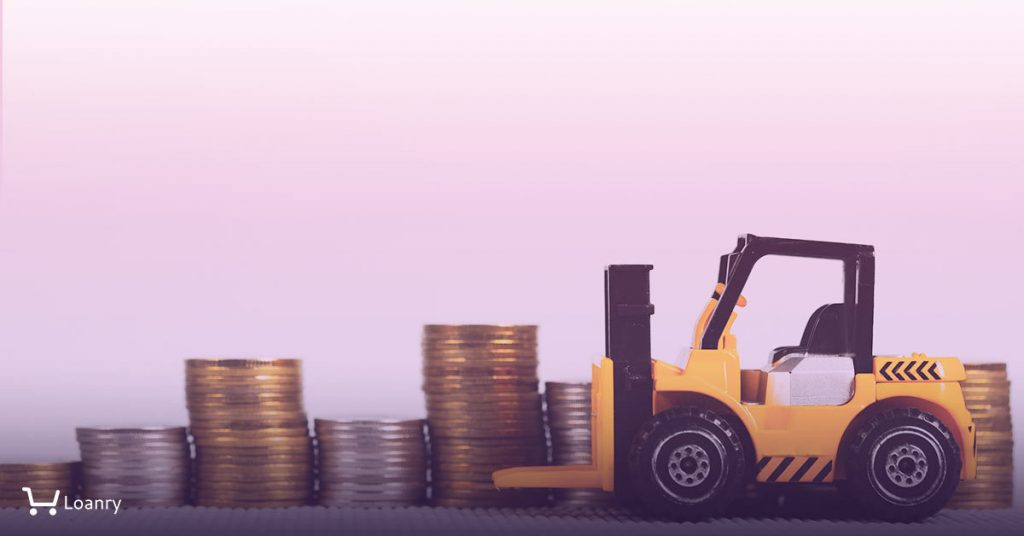 Toy forklift picking up coins