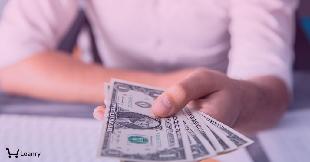 Man hand money with document on desk