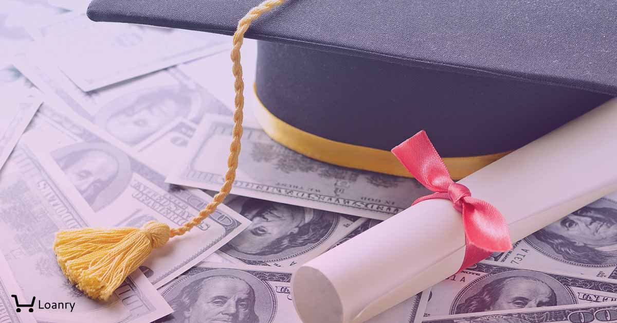 Graduation cap and diploma on hundred dollars