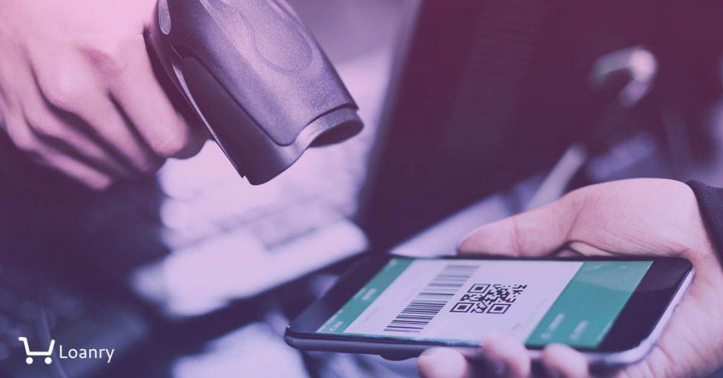 A man scanning a QR code on mobile app