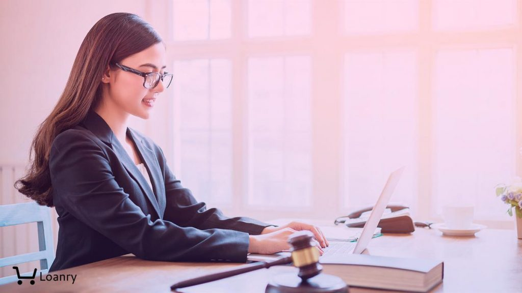 Asian business lawyer woman working with computer laptop in legal office.