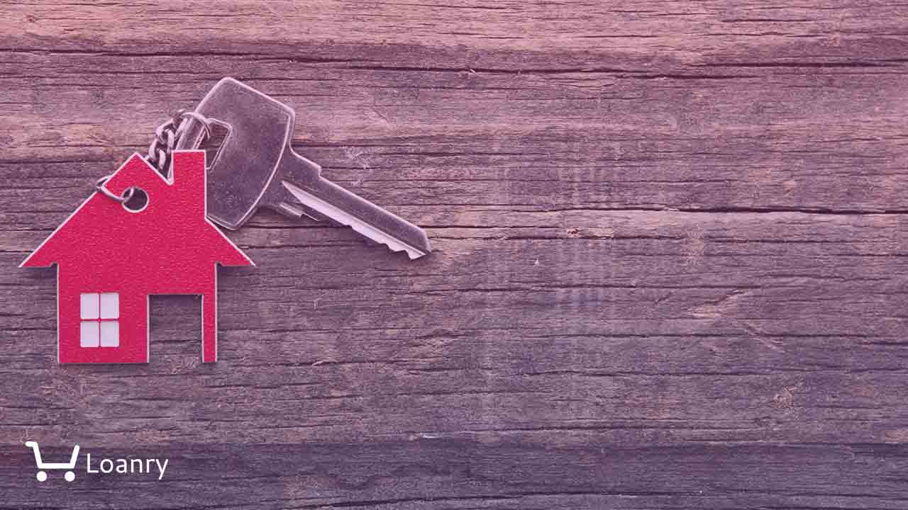 Symbol of the house with silver key on vintage wooden background.