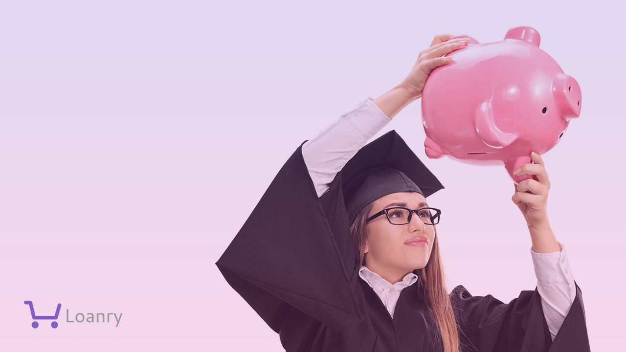Worried graduate student shaking a piggybank isolated on white background.