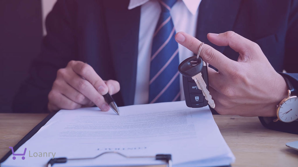 Successful businessman offering a car key with contract.
