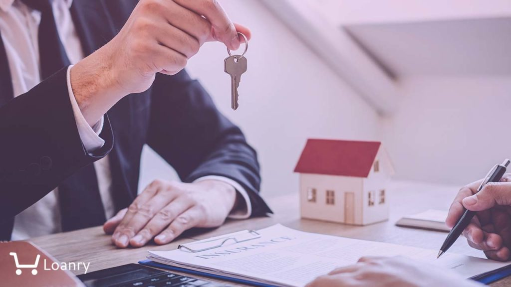 Estate agent giving house keys to client after signing agreement contract real estate with approved mortgage application form