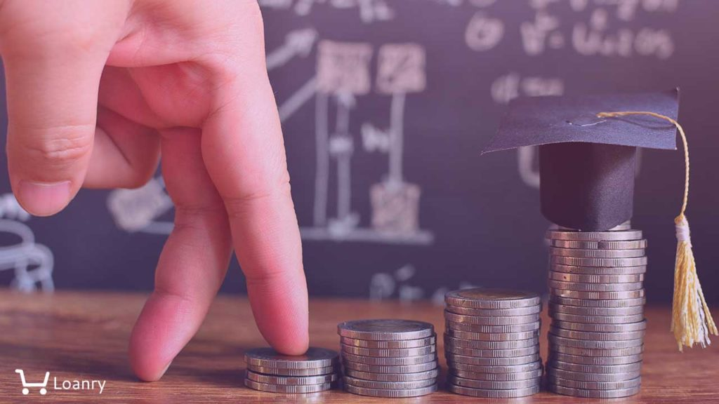 Fingers walking on pile coins saving to hat graduation model